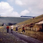 Date - 14/08/1960. Burdale Tunnel. Photo Ref 236.A family walk the track bed. Burdale tunnel is in the distance with tunnel cottage just visable off the middle of the picture. The plate layers hut in photo ref 234 can also be seen. Burdale quarry is on the right©  Len Cook