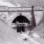 Date - 03/07/1961. Burdale Tunnel. Photo Ref 276.The Southern portal is finally bricked up. Bob Foster is on the ladder, Jerry Leason is on his left, whilst Ken Bilton looks on.©  W R Burton Authors Collection