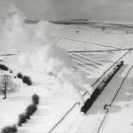 Date - 27/02/1958. Garton. Photo Ref 379.G731 65827 & 69835 Aerial view of parcels train in snow Garton on the Wolds©  GNSRA Forrest Transport Treasury