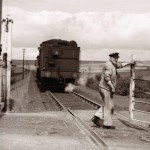 Date - 1956. Garton. Photo Ref 391.The guard opening the gates for the pick-up freight on Garton Slack Crossing.©  A M Ross