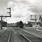 Date - 08/1956. Driffield. Photo Ref 409.A B1 4-6-0 (no.61377) heads out of Driffield for Bridlington across Eastgate South level crossing with an excursion on Bank Holiday Monday August 1956©  A M Ross