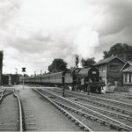 Date - 08/1956. Driffield. Photo Ref 410.Crab 2-6-0 No 42938 restarts an excursion from Normanton to Bridlington after a signal check at Wansford. Note the board signal on the left controlling the sidings at the crossing©  A M Ross