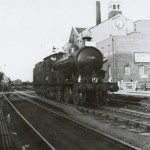 Date - 02/06/1957. Driffield. Photo Ref 262.The gate to the right of the loco is the level crossing crossing gate that allowed traffic to cross the 9 lines that where once here. The footbridge is now in this location, and the crossing long gone. Loco 62387 running a Railtour organised by the Branch Line Society.©  R Casserley