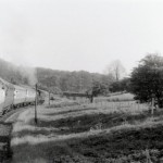 Date - 02/06/1957. Wharram. Photo Ref 264.The train has just left the Southern portal of Burdale tunnel and is going under the bridge. The train will shortly enter Wharram station. Loco number 62387 running a Railtour organised by the Branch Line Society©  R Casserley