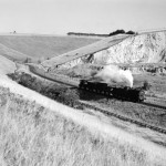 Date - 1957. Burdale. Photo Ref 398.Malton based J27 0-6-0 passing the quarries and approaching the station with the pick-up freight.  Probably photographed in 1957. ©  A M Ross